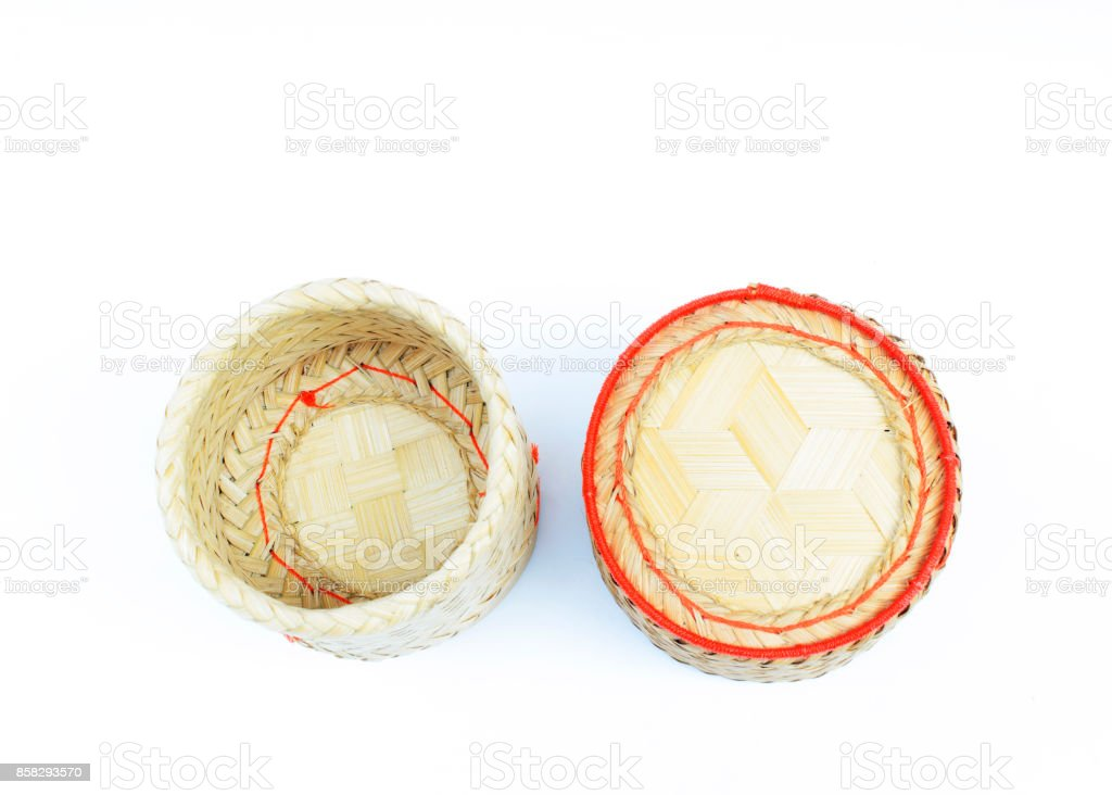Kratip rice - Bamboo basket of Thai homemade for keep sticky rice on white backgrounds above stock photo