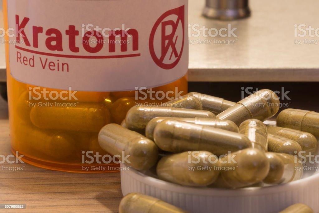 Kratom pills on a desk Image of actual kratom pills with a faux prescription logo. Capsule - Medicine Stock Photo