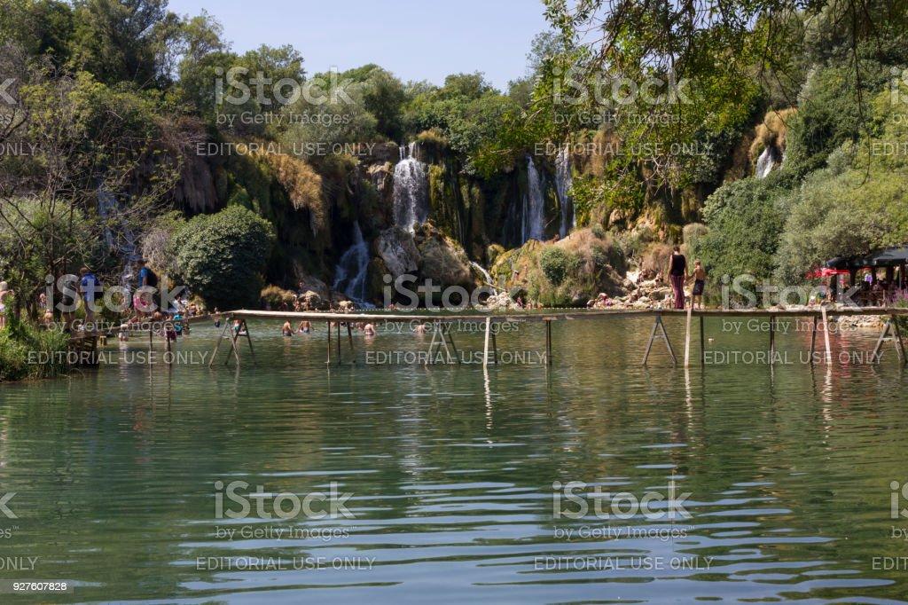 Kravice waterfalls  in Bosnia Herzegovina, with a floating wooden bridge stock photo