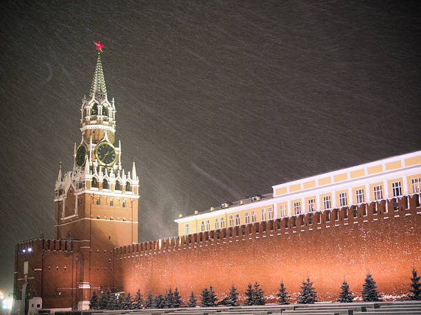 Kremlin in winter Kremlin in snowfall, Spasskaya tower, Moscow, Russia kremlin stock pictures, royalty-free photos & images