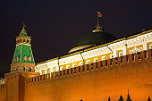 Kremlin tower and brick wall on Red Square in Moscow night view