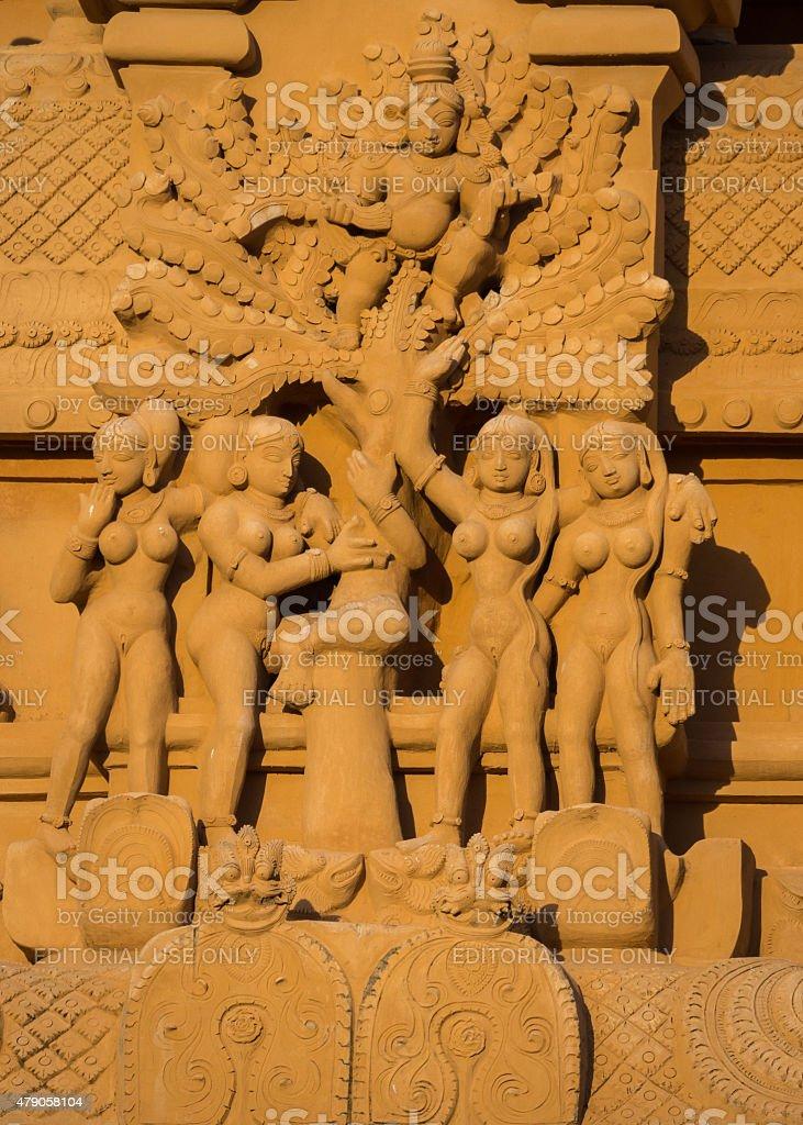 Krishna flees angry, naked women statue. stock photo