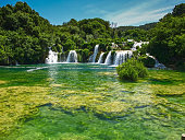 Waterfalls in Krka National Park. Krka river runs from the Adriatic near Šibenik inland to the mountains of the Croatian interior. It's a magical place of waterfalls and gorges, with the river gushing through a karstic canyon.