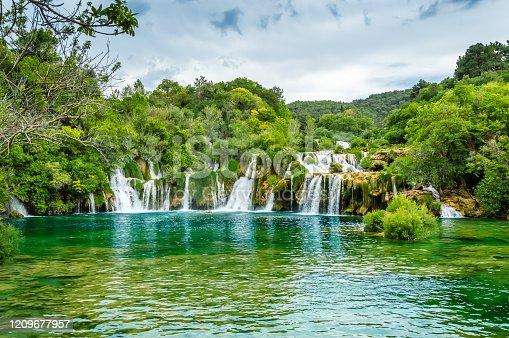 Beautiful Krka Waterfalls in Krka National Park, Croatia. Skradinski buk is the longest waterfall on the Krka River with clear turquoise water and dense forest. Long exposure for flowing water.