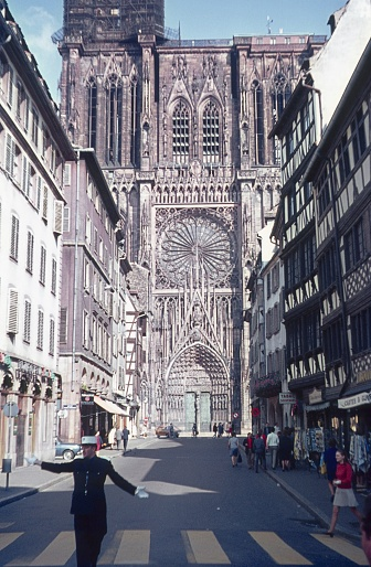 Strasbourg, Alsace, France, 1969. Krämergasse in Strasbourg with the west facade of the Strasbourg Cathedral in the background. Furthermore: traffic policeman, passers-by and half-timbered houses.
