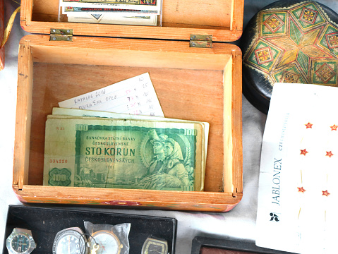 istock 100 kronas of Czechoslovakia in wooden casket on open air market of vintage things on the site of Red stone castle 1217371343