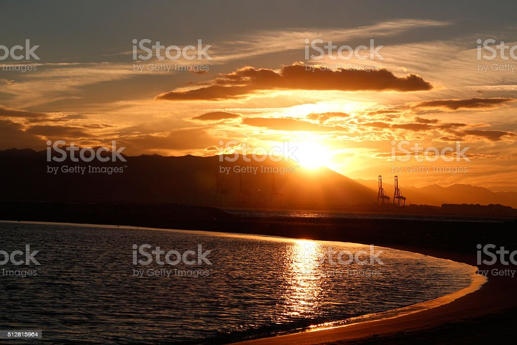Küste und Kräne im Sonneuntergang stock photo