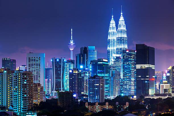 kuala lumpur illuminated skyline at night - 쿠알라룸푸르 뉴스 사진 이미지