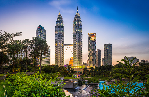 Kuala Lumpur KLCC Park Petronas Towers illuminated at sunset Malaysia