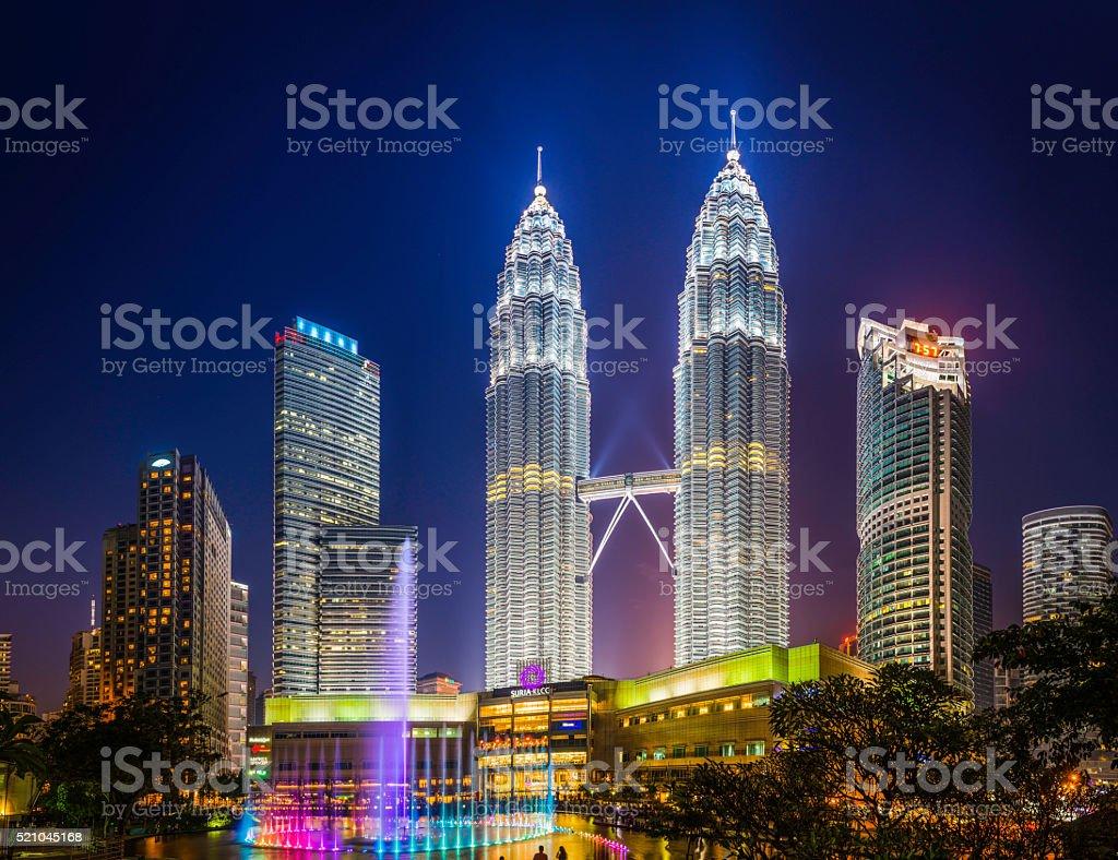 Kuala Lumpur neon night Petronas Towers KLCC Park illuminated Malaysia stock photo