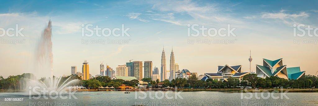 Kuala Lumpur Petronas Towers landmark cityscape skyscrapers fountain sunset Malaysia stock photo