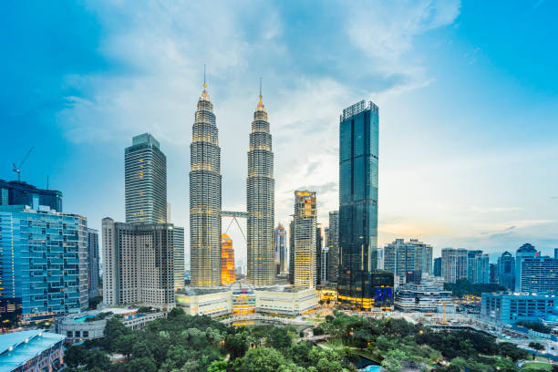Kuala Lumpur Skyline with Petronas Towers at sunset stock photo