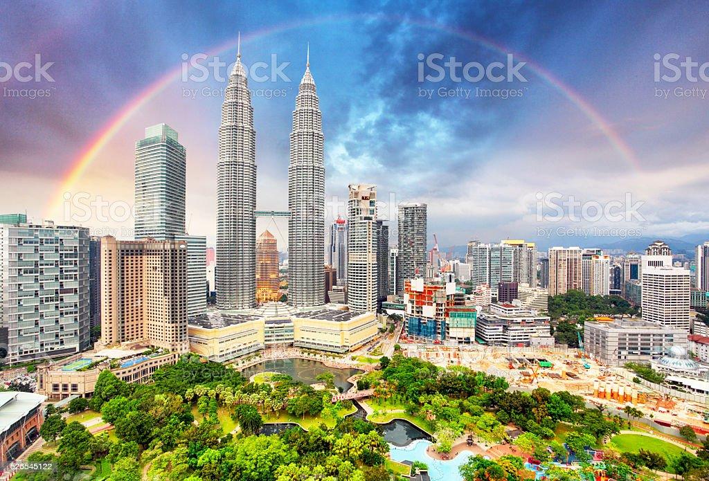 Kuala Lumpur skyline with rainbow stock photo