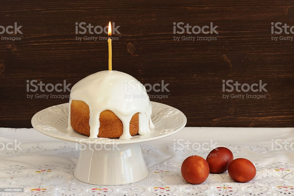 Kulich, traditional Russian easter cake with royal icing, lit ca royalty-free stock photo