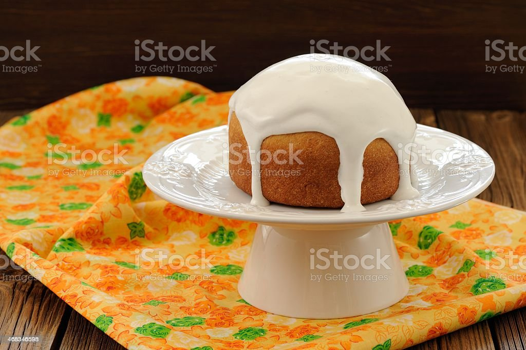 Kulich, traditional Russian easter cake with royal icing on whit royalty-free stock photo