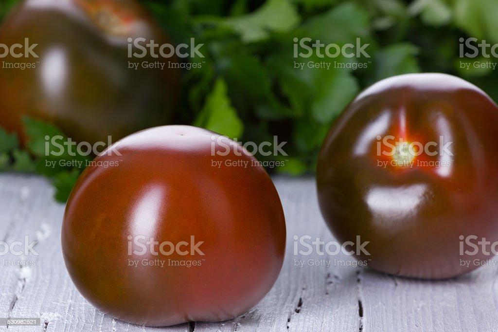 kumato, black tomatoes stock photo