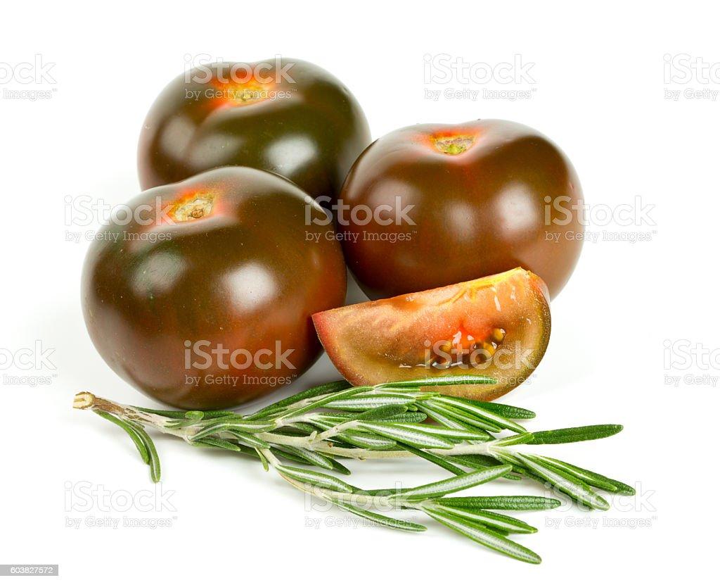 kumato tomatoes isolated on white background stock photo