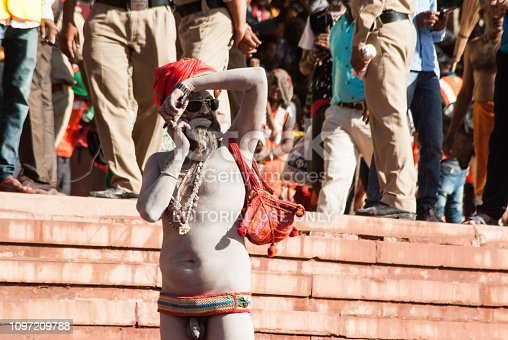 Ujjain, Madhya Pradesh, India - April 22, 2016 : Saint talked on mobile
