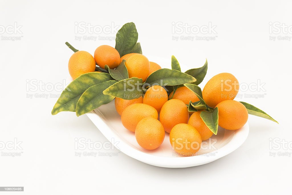 Kumquats on Plate, Fresh Fruit, Nutritious Food royalty-free stock photo