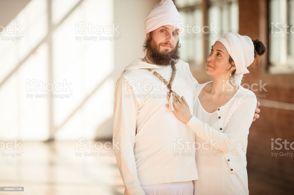 Kundalini Wedding in traditional clothing. A couple getting married stock photo