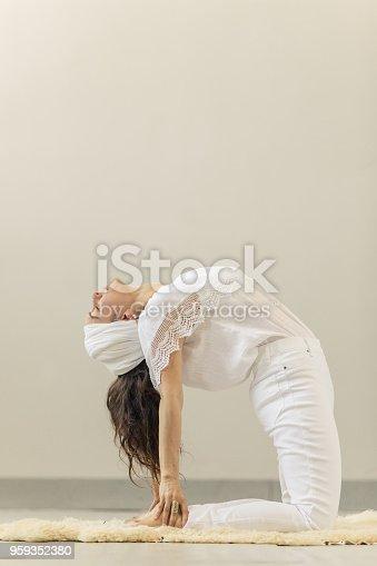 Kundalini. Woman practicing yoga. Bow pose
