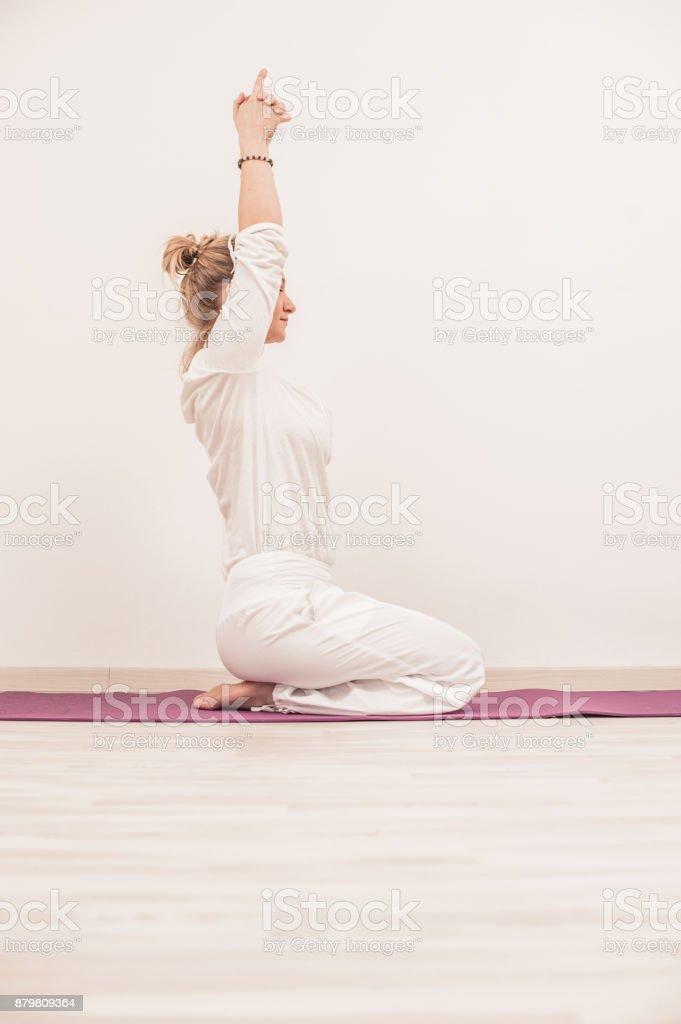 Kundalini Yoga Meditation with Mudra, Sat Kriya stock photo