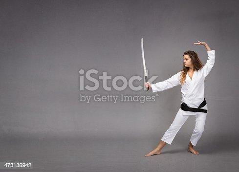 497607484 istock photo kung fu with katana on hand 473136942