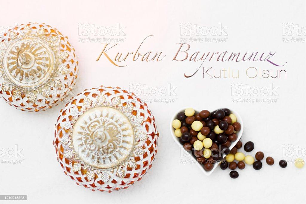 Kurban Bayram sacrifice festival, Islamic Arabic candle and chocolate sugar. Kurban bayraminiz kutlu olsun means happy festival of sacrifices stock photo