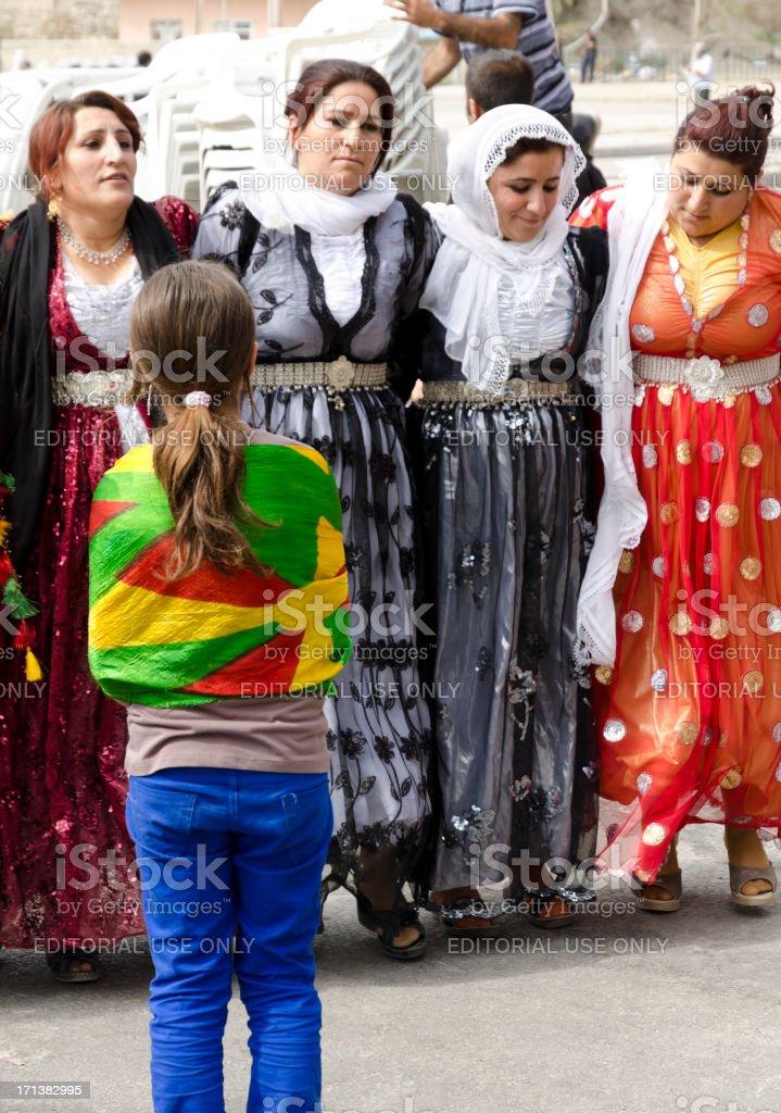 Kurdish women in traditional dress dancing (Halay) royalty-free stock photo