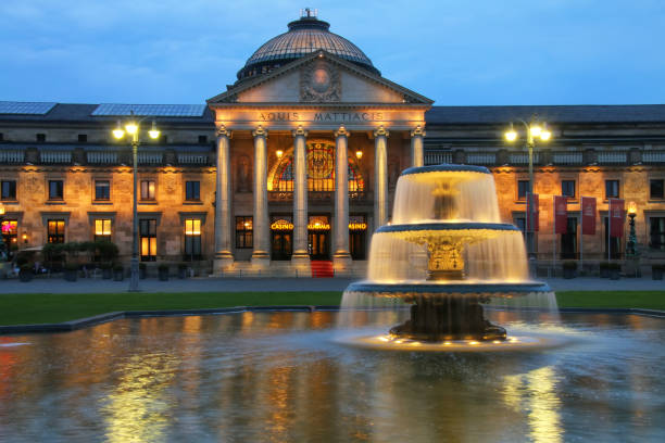Kurhaus and Bowling Green in the evening with lights, Wiesbaden, stock photo