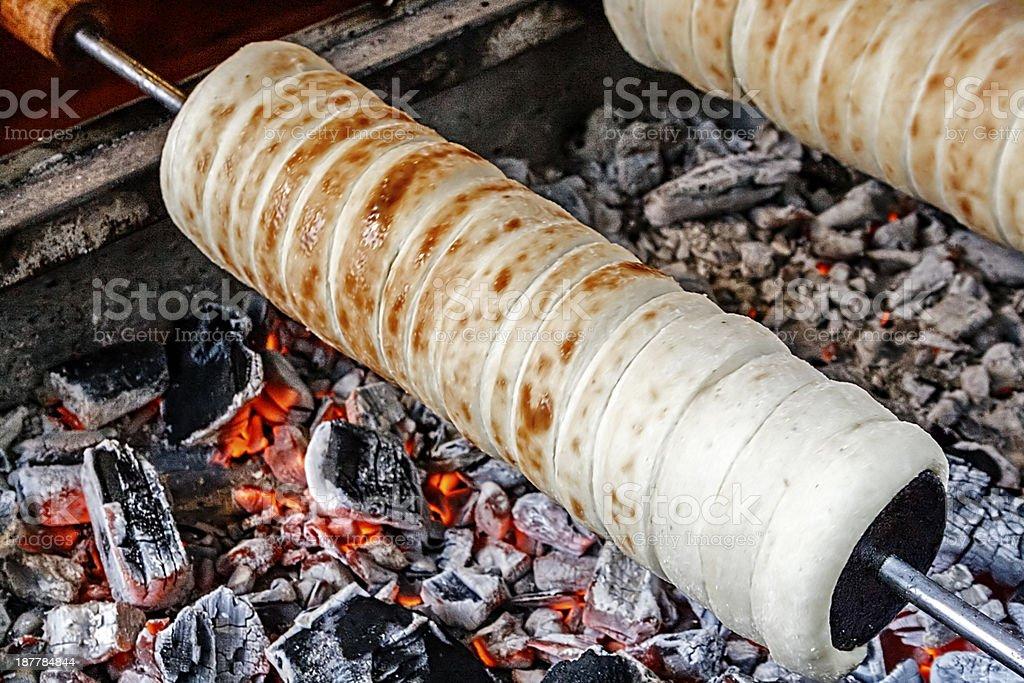 Kurtoskalacs prepared on the grill stock photo