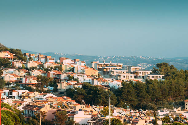 Kusadasi, Turkey. Beautiful Cityscape Of Turkish Town. White Residential Houses On Hillside. Real Estate Suburb In Summer Evening stock photo