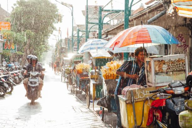 Kuta street under the rain, Bali stock photo