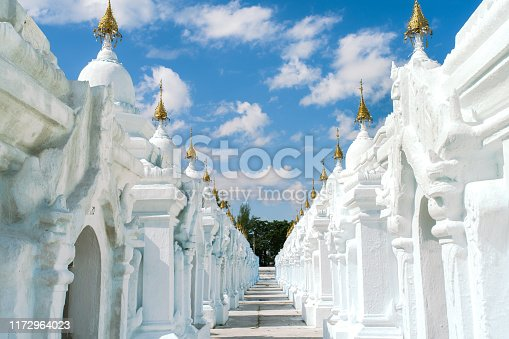 Kuthodaw Pagoda (literally Royal Merit, and formally titled Mahalawka Marazein), a Buddhist stupa that contains the world's largest book, lies at the foot of Mandalay Hill, Mandalay, Myanmar