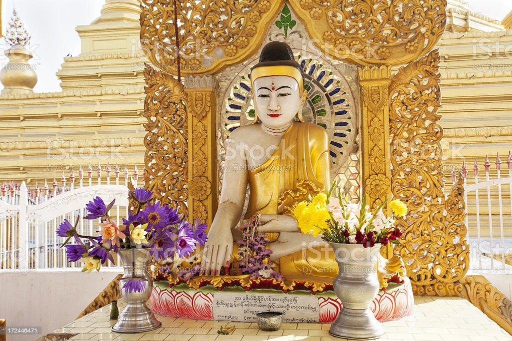 Kuthowdaw Pagoda with Buddha statur in Mandalay stock photo