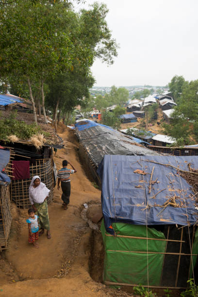 Kutupalong refugee camp in Bangladesh Kutupalong refugee camp, Bangladesh - October 29, 2017: Basic shelters packed close together are the homes of hundreds of thousands of Rohingya Muslims living in this and other refugee camps near Cox's Bazar, Bangladesh. rohingya culture stock pictures, royalty-free photos & images
