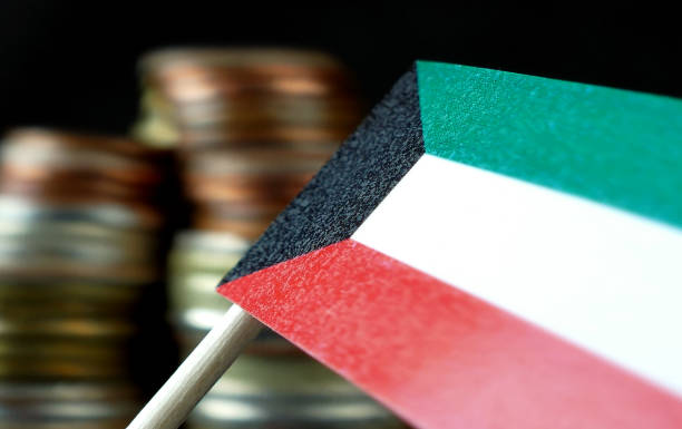 kuwait flag waving with stack of money coins macro - kuwait currency stock photos and pictures