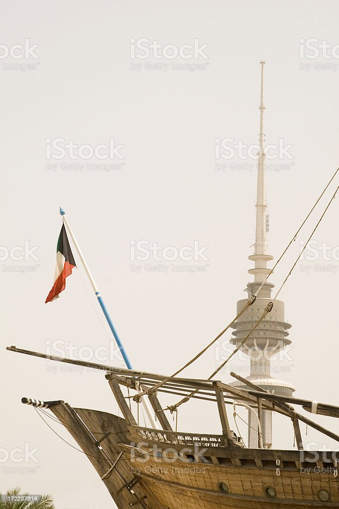 Kuwait liberation tower and dhow royalty-free stock photo