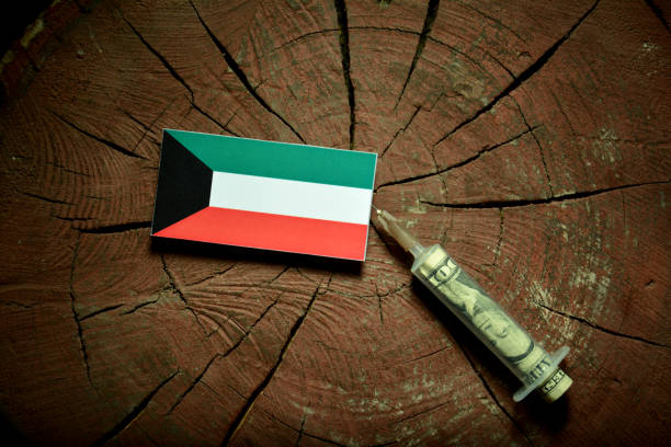 kuwaiti flag on a stump with syringe injecting money in flag - kuwait currency stock photos and pictures