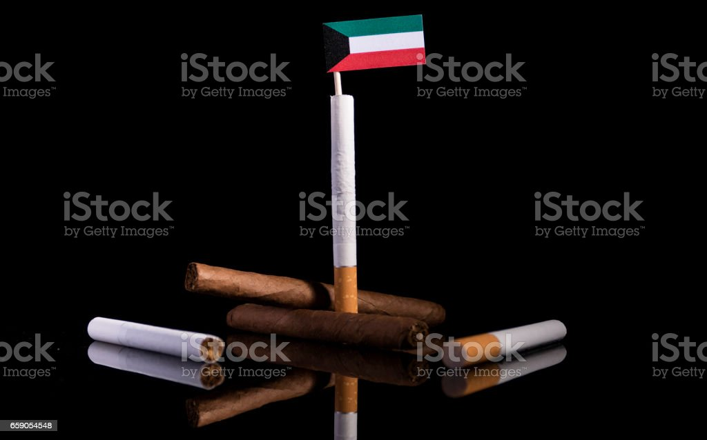 Kuwaiti flag with cigarettes and cigars. Tobacco Industry concept. royalty-free stock photo