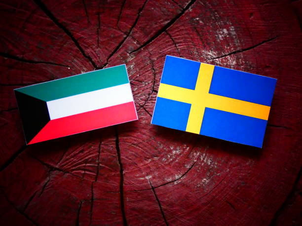 kuwaiti flag with swedish flag on a tree stump isolated - kuwait currency stock photos and pictures