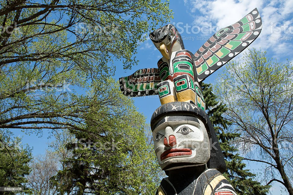 Kwakiutl Totem Pole at Wascana Lake in Regina Saskatchewan stock photo
