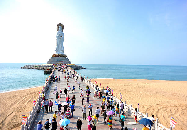 kwan-yin statue in hainan island Goddess of  mercy statue at seaside in nanshan temple,sanya city,china bodhisattva stock pictures, royalty-free photos & images