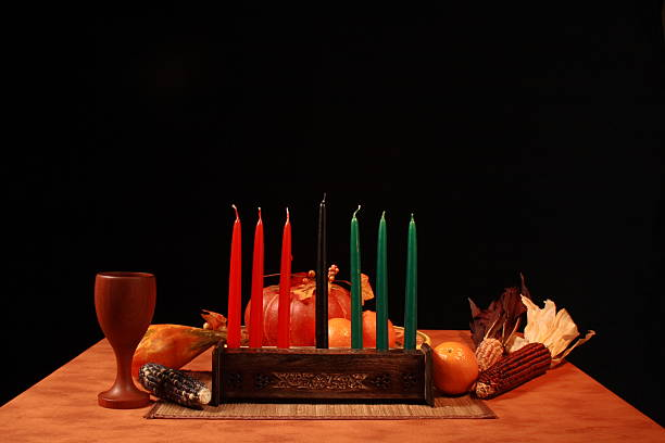 kwanza table unlit candles low angle - kwanzaa stock pictures, royalty-free photos & images