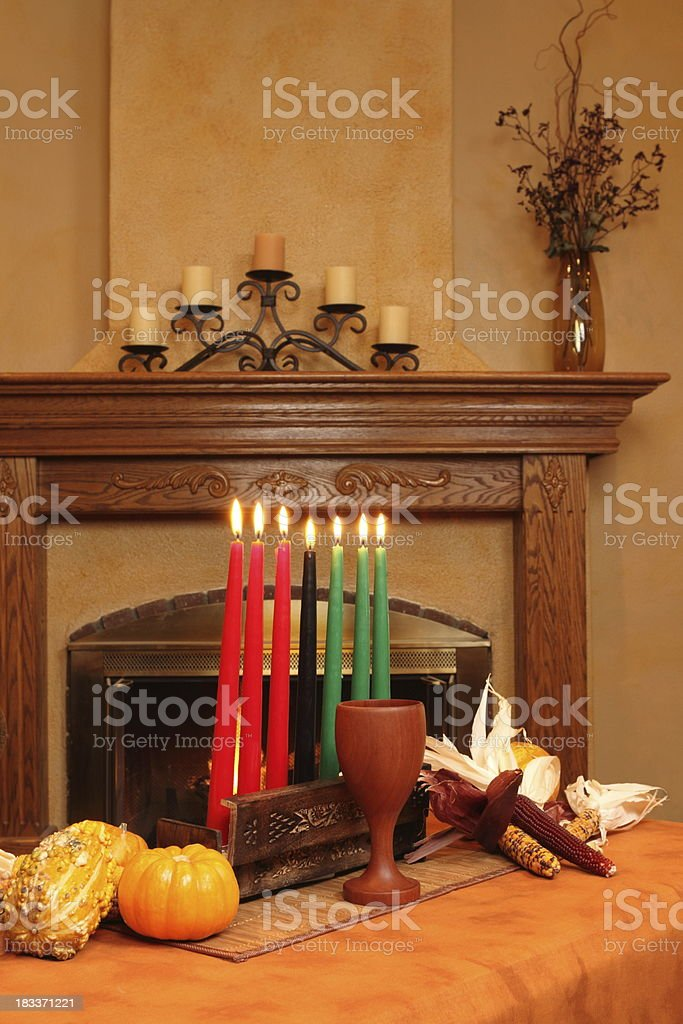 Kwanzaa Candles By Fireplace All Lit Vertical stock photo