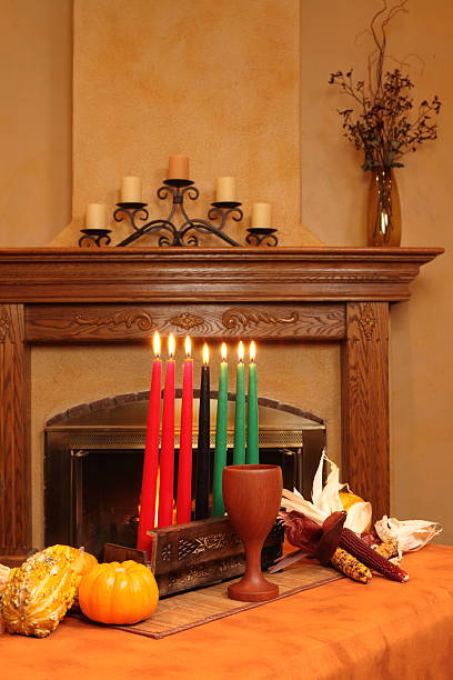 kwanzaa candles by fireplace all lit vertical - kwanzaa stock pictures, royalty-free photos & images