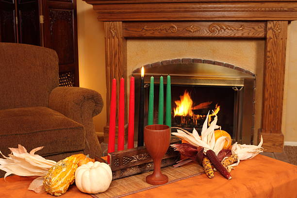 kwanzaa candles by fireplace horizontal - kwanzaa stock pictures, royalty-free photos & images
