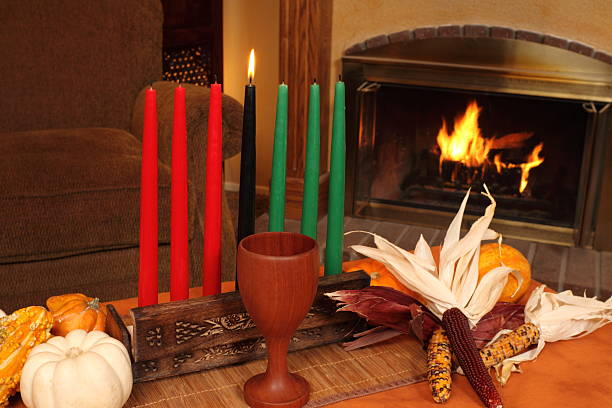 kwanzaa candles by fireplace medium horizontal - kwanzaa stock pictures, royalty-free photos & images