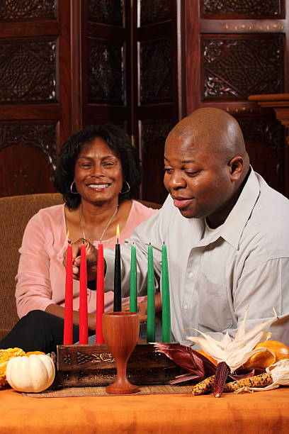 kwanzaa couple verical - kwanzaa stock pictures, royalty-free photos & images