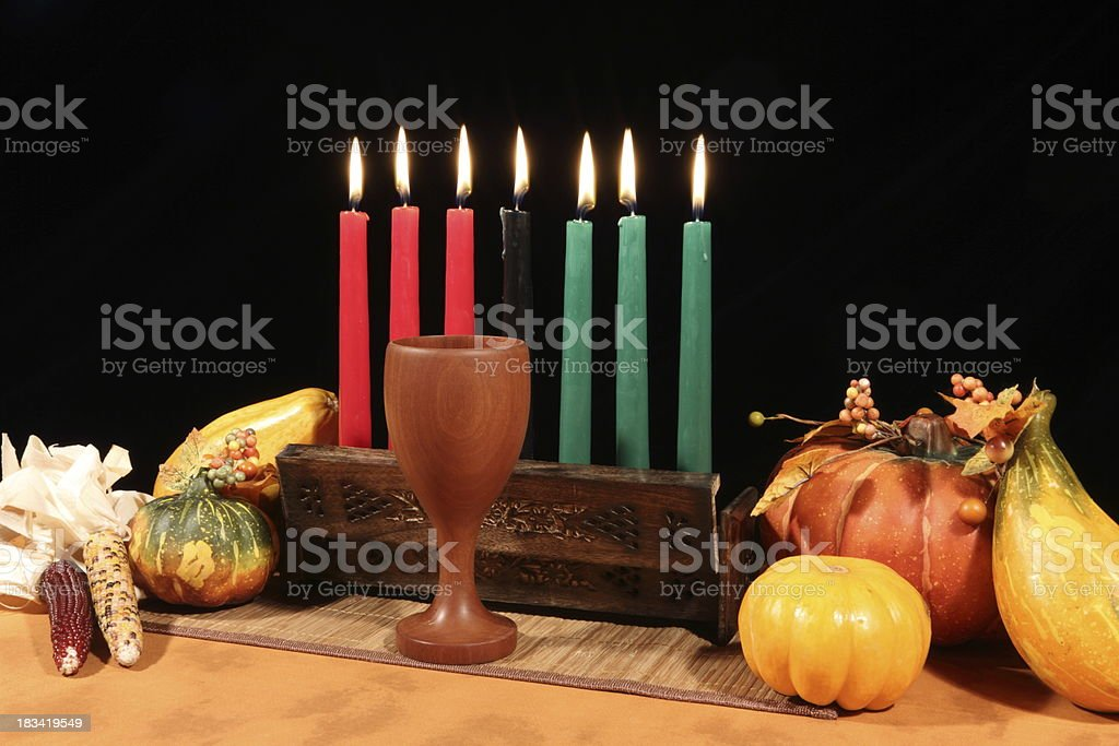 Kwanzaa Display on Black All Candles Lit royalty-free stock photo